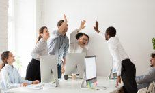 Happy Multi Ethnic Employees Sales Team Giving High Five Togethe